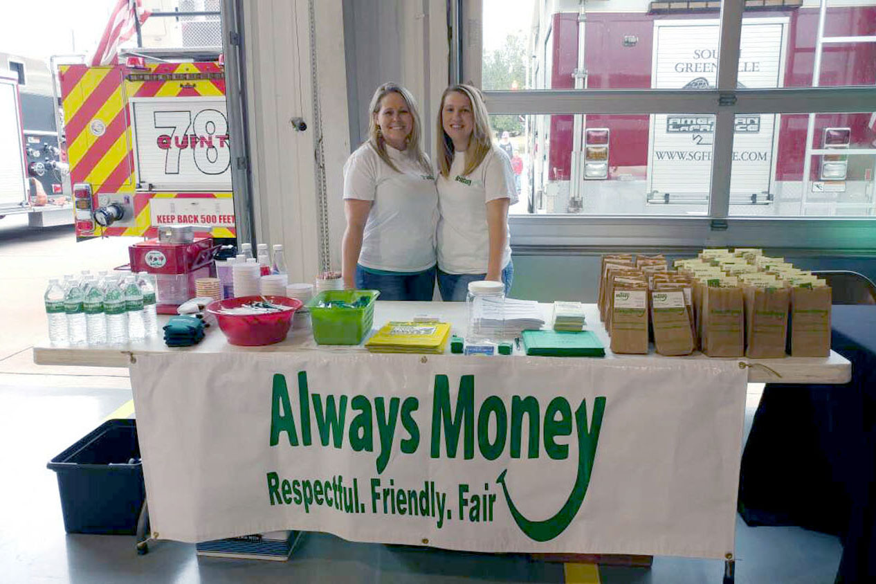 Ladies-at-stall-desk-AlwaysMoneyFinance